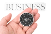 bigstock_Compass_And_Business_Sign_3130944